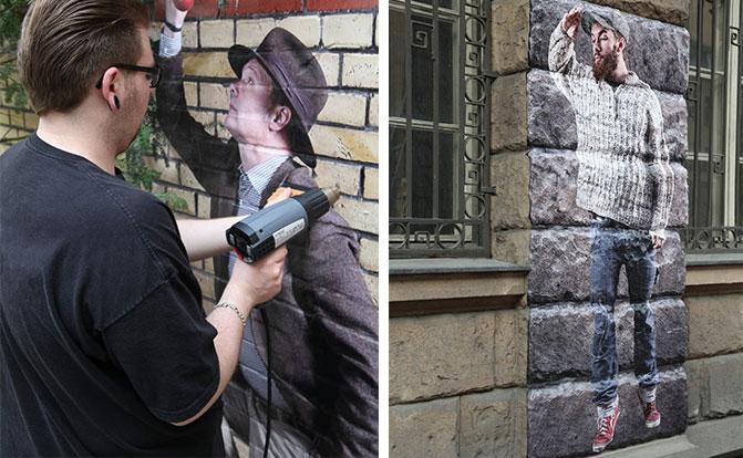 Mitarbeiter der Wezet Beschriftungsfabrik bringt Fassadenfolie an